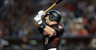 Sep 22, 2018; Phoenix, AZ, USA; Arizona Diamondbacks center fielder A.J. Pollock (11) hits a solo home run against the Colorado Rockies during the fifth inning at Chase Field. Mandatory Credit: Joe Camporeale-USA TODAY Sports