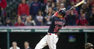 Cleveland Indians left fielder Michael Brantley (23) hits a single to score the game winning run against the Boston Red Sox during the eleventh inning at Progressive Field. The Indians won 5-4.
