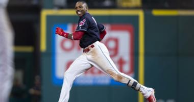 Sep 23, 2018; Cleveland, OH, USA; Cleveland Indians infielder Yandy Diaz (36) congratulates center fielder Greg Allen (1) on his game-winning walk-off hit during the eleventh inning against the Boston Red Sox at Progressive Field.