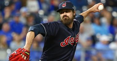 Sep 27, 2018; Kansas City, MO, USA; Cleveland Indians relief pitcher Andrew Miller (24) pitches against the Kansas City Royals in the fifth inning at Kauffman Stadium. Mandatory Credit: Jay Biggerstaff-USA TODAY Sports