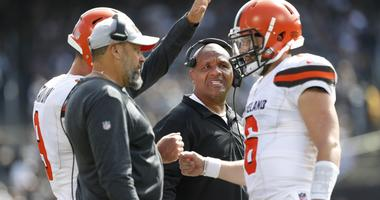 Cleveland Browns head coach Hue Jackson stands on the sideline after a Browns touchdown against the Oakland Raiders in the second quarter at Oakland Coliseum.