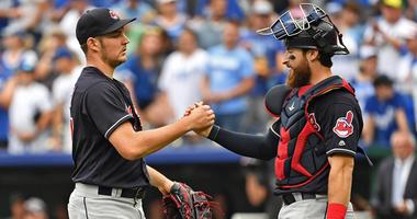 Sep 30, 2018; Kansas City, MO, USA; Cleveland Indians starting pitcher Trevor Bauer (47) shakes hands with catcher Eric Haase (38) after beating the Kansas City Royals at Kauffman Stadium.