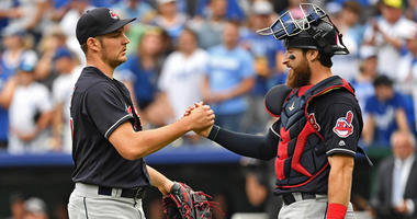 Sep 30, 2018; Kansas City, MO, USA; Cleveland Indians starting pitcher Trevor Bauer (47) shakes hands with catcher Eric Haase (38) after beating the Kansas City Royals at Kauffman Stadium.