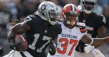 Oakland Raiders wide receiver Dwayne Harris (17) runs against Cleveland Browns defensive back Denzel Rice (37) during the fourth quarter at Oakland Coliseum.