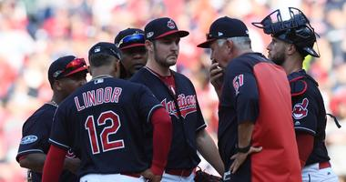Oct 8, 2018; Cleveland, OH, USA; Cleveland Indians pitching coach Carl Willis (51) talks to starting pitcher Trevor Bauer (47) in the seventh inning against the Houston Astros during game three of the 2018 ALDS playoff baseball series at Progressive Field