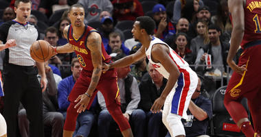 Cleveland Cavaliers guard George Hill (3) controls the ball as Detroit Pistons guard Ish Smith (14) defends during the second quarter at Little Caesars Arena.