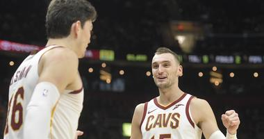 Cleveland Cavaliers forward Sam Dekker (15) celebrates with forward Cedi Osman (16) in the third quarter against the Atlanta Hawks at Quicken Loans Arena.
