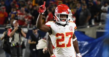 Nov 19, 2018; Los Angeles, CA: Kansas City Chiefs running back Kareem Hunt (27) celebrates scoring in the second quarter against the Los Angeles Rams at the Los Angeles Memorial Coliseum. Mandatory Credit: Robert Hanashiro-USA TODAY Sports