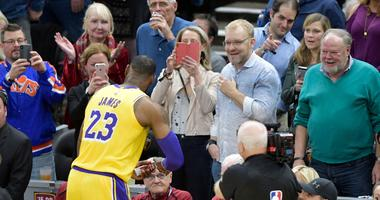 Nov 21, 2018; Cleveland, OH, USA; Fans watch as Los Angeles Lakers forward LeBron James (23) prior to a game against the Cleveland Cavaliers at Quicken Loans Arena. Mandatory Credit: David Richard-USA TODAY Sports