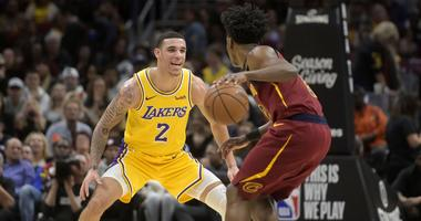 Nov 21, 2018; Cleveland, OH, USA; Los Angeles Lakers guard Lonzo Ball (2) defends Cleveland Cavaliers guard Collin Sexton (2) in the second quarter at Quicken Loans Arena. Mandatory Credit: David Richard-USA TODAY Sports