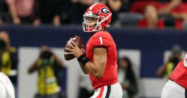 Georgia Bulldogs quarterback Justin Fields (1) looks to throw against the Alabama Crimson Tide during the second quarter in the SEC championship game at Mercedes-Benz Stadium.