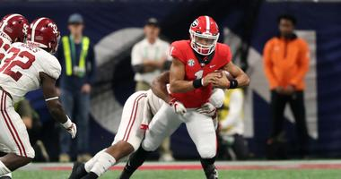 Dec 1, 2018; Atlanta, GA, USA; Georgia Bulldogs quarterback Justin Fields (1) runs the ball against the Alabama Crimson Tide during the fourth quarter in the SEC championship game at Mercedes-Benz Stadium. Mandatory Credit: Jason Getz-USA TODAY Sports