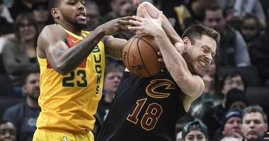 Dec 10, 2018; Milwaukee, WI, USA; Milwaukee Bucks guard Sterling Brown (23) and Cleveland Cavaliers guard Matthew Dellavedova (8) battle for a rebound in the third quarter at the Fiserv Forum. Mandatory Credit: Benny Sieu-USA TODAY Sports