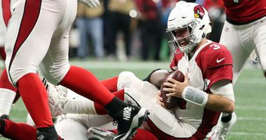 Arizona Cardinals quarterback Josh Rosen (3) is sacked by Atlanta Falcons defensive end Bruce Irvin (52) in the third quarter at Mercedes-Benz Stadium.