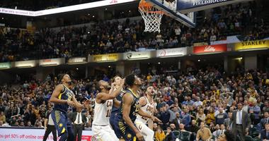 Dec 18, 2018; Indianapolis, IN, USA; A tip in at the buzzer by Cleveland Cavaliers forward Larry Nance Jr. (22) gives the Cavaliers a one point victory against the Indiana Pacers during the fourth quarter at Bankers Life Fieldhouse. Mandatory Credit: Bria