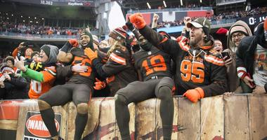Dec 23, 2018; Cleveland, OH, USA; Cleveland Browns linebacker Xavier Woodson-Luster (56) and wide receiver Breshad Perriman (19) celebrate with fans after the Browns beat the Cincinnati Bengals at FirstEnergy Stadium. Mandatory Credit: Ken Blaze-USA TODAY