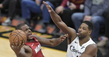 iami Heat guard Dion Waiters (11) drives to the basket against Cleveland Cavaliers center Tristan Thompson (13) in the fourth quarter at Quicken Loans Arena.