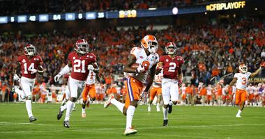 Jan 7, 2019; Santa Clara, CA, USA; Clemson Tigers wide receiver Justyn Ross (8) gets past Alabama Crimson Tide defensive back Jared Mayden (21) and scores a touchdown in the third quarter during the 2019 College Football Playoff Championship game at Levi'