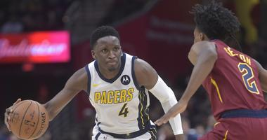 Jan 8, 2019; Cleveland, OH, USA; Indiana Pacers guard Victor Oladipo (4) dribbles against Cleveland Cavaliers guard Collin Sexton (2) in the second quarter at Quicken Loans Arena. Mandatory Credit: David Richard-USA TODAY Sports