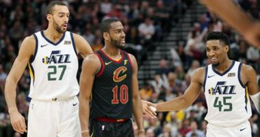 Jan 18, 2019; Salt Lake City, UT, USA; Utah Jazz center Rudy Gobert (27) congratulates guard Donovan Mitchell (45) for getting Cleveland Cavaliers guard Alec Burks (10) to foul Mitchell while shooting during the second quarter at Vivint Smart Home Arena.