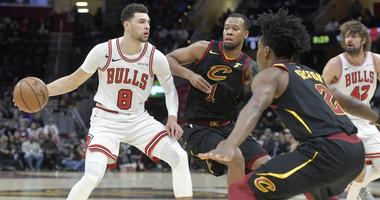 Jan 21, 2019; Cleveland, OH, USA; Chicago Bulls guard Zach LaVine (8) dribbles against Cleveland Cavaliers guard Rodney Hood (1) and guard Collin Sexton (2) in the third quarter at Quicken Loans Arena. Mandatory Credit: David Richard-USA TODAY Sports
