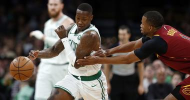 Jan 23, 2019; Boston, MA, USA; Boston Celtics guard Terry Rozier (12) tries to evade Cleveland Cavaliers guard Rodney Hood (1) during the first half at TD Garden. Mandatory Credit: Greg M. Cooper-USA TODAY Sports