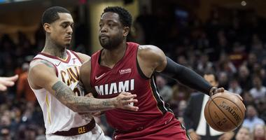 Jan 25, 2019; Cleveland, OH, USA; Miami Heat guard Dwyane Wade (3) drives to the basket against Cleveland Cavaliers guard Jordan Clarkson (8) during the first half at Quicken Loans Arena. Mandatory Credit: Ken Blaze-USA TODAY Sports