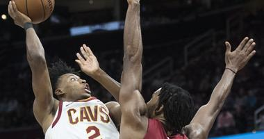 Cleveland Cavaliers guard Collin Sexton (2) shoots over the defense of Miami Heat forward Justise Winslow (20) during the second half at Quicken Loans Arena.