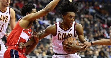Feb 8, 2019; Washington, DC, USA; Cleveland Cavaliers guard Collin Sexton (2) controls the ball as Washington Wizards guard Chasson Randle (9) defends during the first quarter at Capital One Arena. Mandatory Credit: Brad Mills-USA TODAY Sports