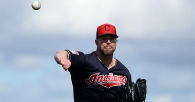 Feb 18, 2019; Goodyear, AZ, USA; Cleveland Indians starting pitcher Corey Kluber (28) throws during a spring training workout at the Goodyear Ballpark practice fields. Mandatory Credit: Joe Camporeale-USA TODAY Sports