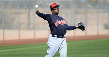 Feb 18, 2019; Goodyear, AZ, USA; Cleveland Indians second baseman Jose Ramirez (11) throws during a spring training workout at the Goodyear Ballpark practice fields. Mandatory Credit: Joe Camporeale-USA TODAY Sports