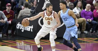 Feb 23, 2019; Cleveland, OH, USA; Cleveland Cavaliers forward Kevin Love (0) dribbles against Memphis Grizzlies forward Ivan Rabb (10) in the first quarter at Quicken Loans Arena. Mandatory Credit: David Richard-USA TODAY Sports