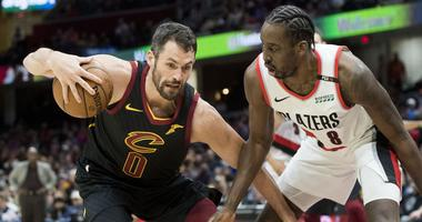 Feb 25, 2019; Cleveland, OH, USA; Portland Trail Blazers forward Al-Farouq Aminu (8) defends Cleveland Cavaliers forward Kevin Love (0) during the first half at Quicken Loans Arena. Mandatory Credit: Ken Blaze-USA TODAY Sports