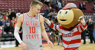 Feb 26, 2019; Columbus, OH, USA; Ohio State Buckeyes forward Justin Ahrens (10) celebrates with mascot Brutus Buckeye after leading the team in scoring against the Iowa Hawkeyes at Value City Arena. Mandatory Credit: Joe Maiorana-USA TODAY Sports