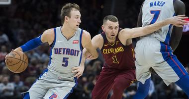 Mar 2, 2019; Cleveland, OH, USA; Detroit Pistons guard Luke Kennard (5) drives to the basket against Cleveland Cavaliers guard Nik Stauskas (1) during the first half at Quicken Loans Arena. Mandatory Credit: Ken Blaze-USA TODAY Sports
