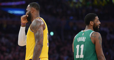 March 9, 2019; Los Angeles, CA, USA; Los Angeles Lakers forward LeBron James (23) speaks with Boston Celtics guard Kyrie Irving (11) during a stoppage in play in the first half at Staples Center. Mandatory Credit: Gary A. Vasquez-USA TODAY Sports