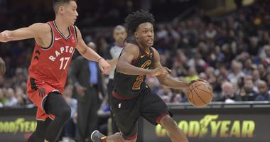 Mar 11, 2019; Cleveland, OH, USA; Cleveland Cavaliers guard Collin Sexton (2) drives against Toronto Raptors guard Jeremy Lin (17) in the fourth quarter at Quicken Loans Arena. Mandatory Credit: David Richard-USA TODAY Sports