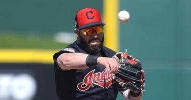 Mar 13, 2019; Goodyear, AZ, USA; Cleveland Indians second baseman Jason Kipnis (22) throws to first base after forcing out Milwaukee Brewers third baseman Hernan Perez (14) at second during the fourth inning at Goodyear Ballpark. Mandatory Credit: Joe Cam