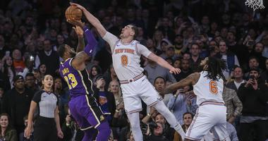 Mar 17, 2019; New York, NY, USA; New York Knicks forward Mario Hezonja (8) blocks Los Angeles Lakers forward LeBron James (23) shot at the buzzer in the Knicks 124-123 victory at Madison Square Garden. Mandatory Credit: Wendell Cruz-USA TODAY Sports