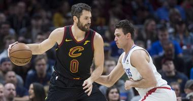 Mar 22, 2019; Cleveland, OH, USA; Los Angeles Clippers forward Danilo Gallinari (8) defends Cleveland Cavaliers forward Kevin Love (0) during the first half at Quicken Loans Arena. Mandatory Credit: Ken Blaze-USA TODAY Sports