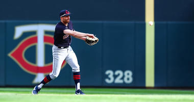 Mar 28, 2019; Minneapolis, MN, USA; Cleveland Indians second baseman Brad Miller (17) throws to first base in the bottom of the eighth inning against the Minnesota Twins at Target Field. The Minnesota Twins defeated the Cleveland Indians 2-0. Mandatory Cr