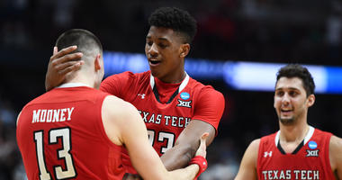 March 30, 2019; Anaheim, CA, USA; Texas Tech Red Raiders guard Matt Mooney (13) guard Davide Moretti (25) and guard Jarrett Culver (23) celebrate the victory against Gonzaga Bulldogs in the championship game of the west regional of the 2019 NCAA Tournamen