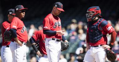 Apr 3, 2019; Cleveland, OH, USA; Cleveland Indians starting pitcher Corey Kluber (center) waits to be relieved during the fourth inning against the Chicago White Sox at Progressive Field. Mandatory Credit: Ken Blaze-USA TODAY Sports