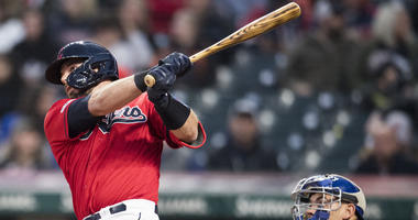 Apr 5, 2019; Cleveland, OH, USA; Cleveland Indians catcher Kevin Plawecki (27) hits a home run during the third inning against the Toronto Blue Jays at Progressive Field. Mandatory Credit: Ken Blaze-USA TODAY Sports