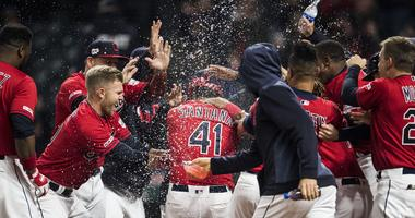 Apr 5, 2019; Cleveland, OH, USA; Cleveland Indians first baseman Carlos Santana (41) is mobbed by teammates after hitting a walk-off home run during the ninth inning against the Toronto Blue Jays at Progressive Field. Mandatory Credit: Ken Blaze-USA TODAY