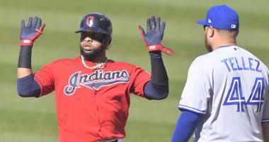 Cleveland Indians first baseman Carlos Santana (41) celebrates after hitting an RBI single in the first inning beside Toronto Blue Jays first baseman Rowdy Tellez (44) at Progressive Field.