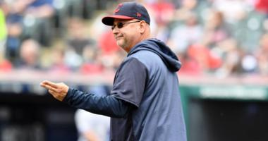 Cleveland Indians manager Terry Francona (77) makes the call to the bullpen during the seventh inning against the Toronto Blue Jays at Progressive Field.