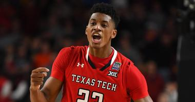 Texas Tech Red Raiders guard Jarrett Culver (23) reacts after a score against the Virginia Cavaliers in the championship game of the 2019 men's Final Four at US Bank Stadium.