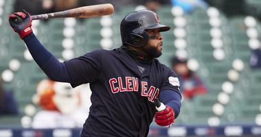 Apr 11, 2019; Detroit, MI, USA; Cleveland Indians first baseman Carlos Santana (41) hits an RBI single in the seventh inning against the Detroit Tigers at Comerica Park. Mandatory Credit: Rick Osentoski-USA TODAY Sports