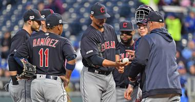 Cleveland Indians starting pitcher Carlos Carrasco (59) gets taken out of the game by Cleveland Indians manager Terry Francona (77)during the first inning against the Kansas City Royals at Kauffman Stadium.